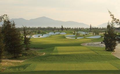 Furama Resort Vietnam golf course trees mountains in distance