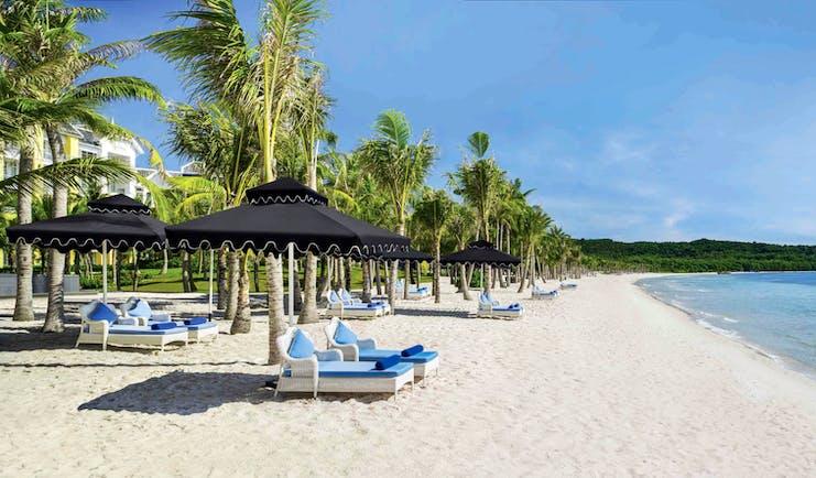 JW Marriott Phu Quoc Vietnam beach white sand sun loungers umbrellas sea palm trees