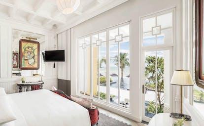 JW Marriott Phu Quoc Vietnam emerald bay guestroom bed elegant décor private balcony overlooking sea