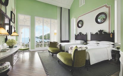JW Marriott Phu Quoc Vietnam emerald bay view guestroom bed chairs elegant décor private terrace