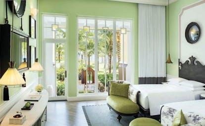 JW Marriott Phu Quoc Vietnam le jardin guestroom beds armchairs elegant décor garden views