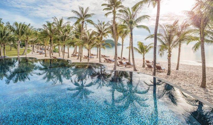 JW Marriott Phu Quoc Vietnam pool overlooking beach sand sea palm trees