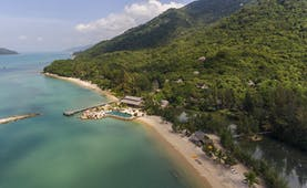 L'Ayla Ninh Van Bay resort, aerial shot of beachside resort with pool, villa nestled in tropical hillside