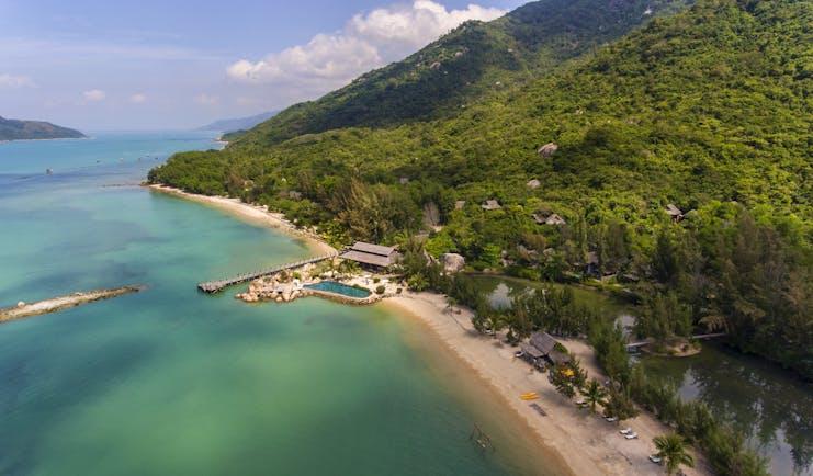 L'Ayla Ninh Van Bay resort, aerial shot of beachside resort with pool, villa nestled in tropical hillside