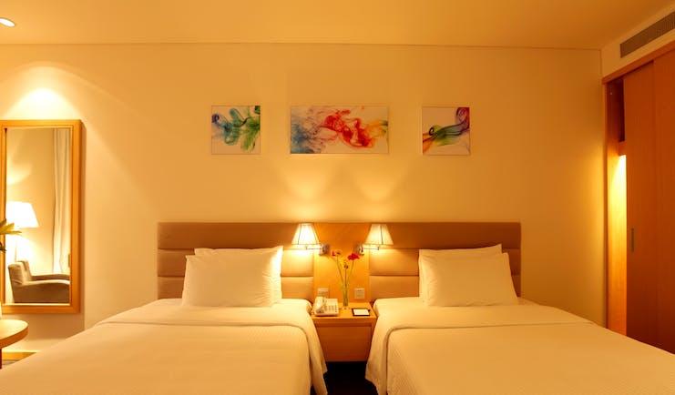 Liberty Central Saigon deluxe twin room, beds, modern decor