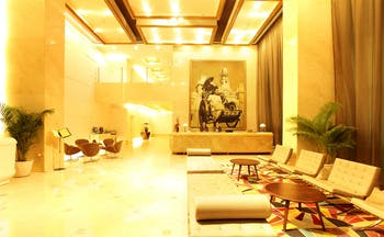 Liberty Central Saigon lobby, grand modern decor, reception desk, sofa, chairs