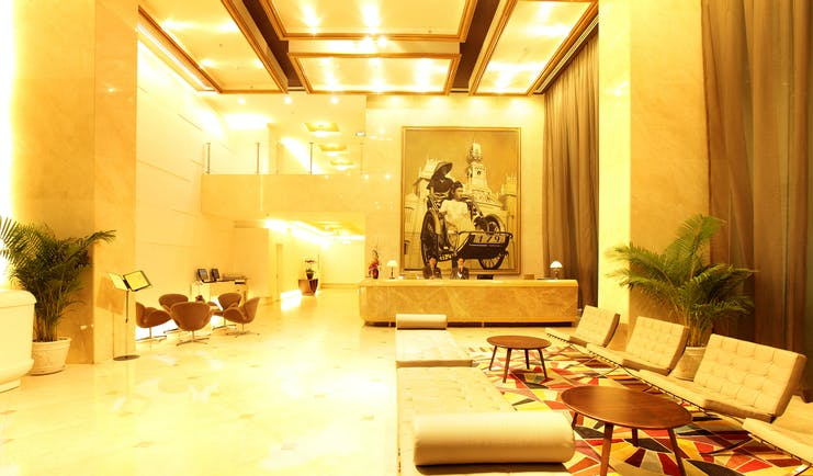 Liberty Central Saigon lobby, grand modern decor, reception desk, sofa, chairs