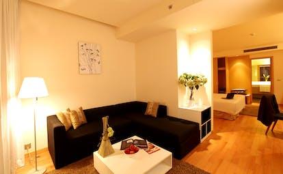 Liberty Central Saigon suite, living area, sofa, bedroom, bright modern decor