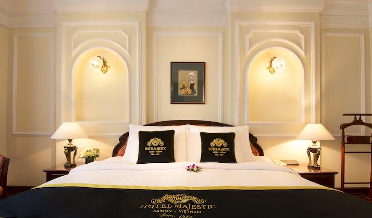 Majestic Hotel Saigon deluxe room, double bed, ornate decor