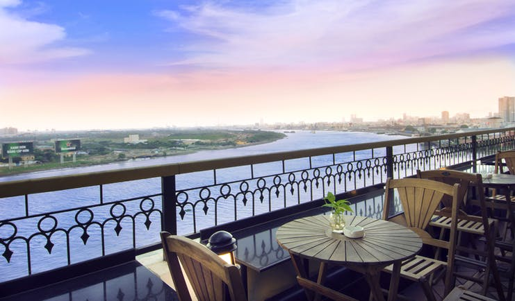 Majestic Hotel Saigon terrace, bar outdoor seating area with view over river