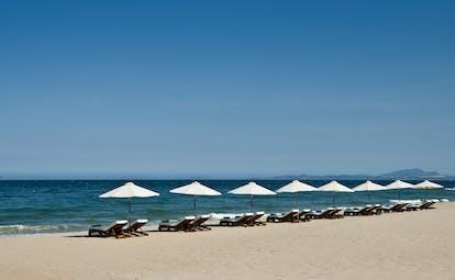 Mia Nha Trang Resort beach loungers, white sandy beach, clear blue sea, loungers and umbrellas