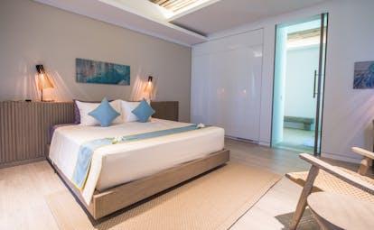 Mia Nha Trang Resort condo bedroom, double bed, chair, colourful modern decor