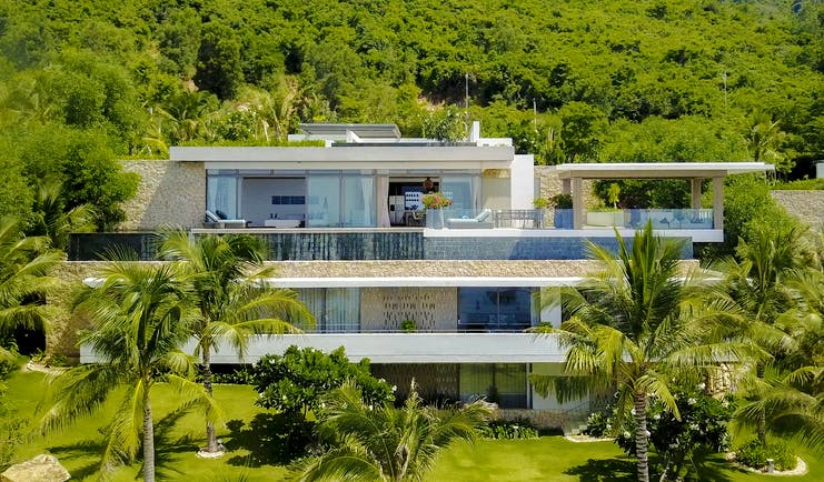Mia Nha Trang Resort five bedroom villa exterior, contemporary architecture, balconies, tropical forest in background