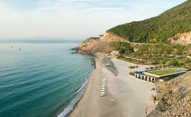 Mia Nha Trang Resort, beach, resort in secluded cove, villas beneath cliffside