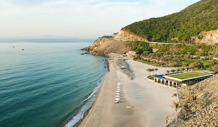 Mia Nha Trang Resort, beach, resort in secluded cove, villas beneath cliffside