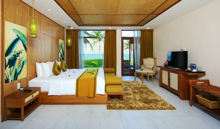 Palm Garden Resort deluxe room, double bed, television, bright modern decor