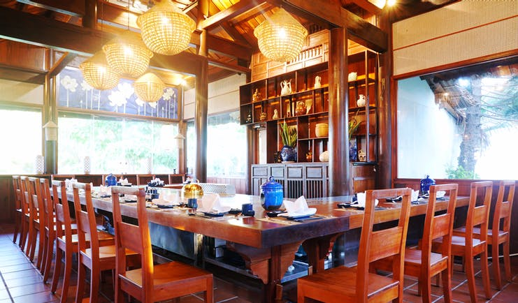 Palm Garden Resort restaurant indoor dining, traditional decor, wooden roof beams, ornate table
