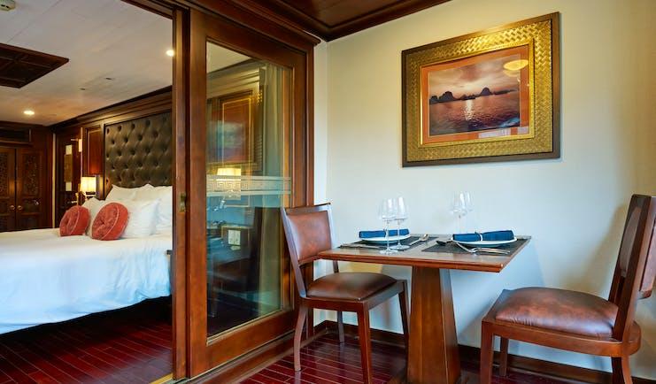 Paradise Peak Cruise junior siute, double bed, living area, traditional decor