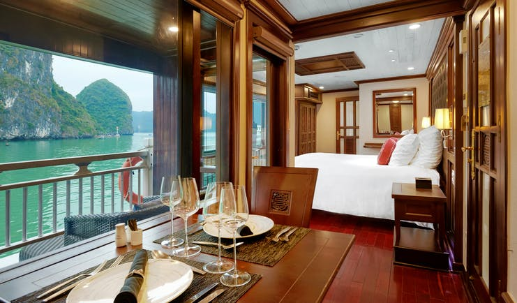 Paradise Peak Cruise superior suite, double bed, living area, largw windows with views over the sea