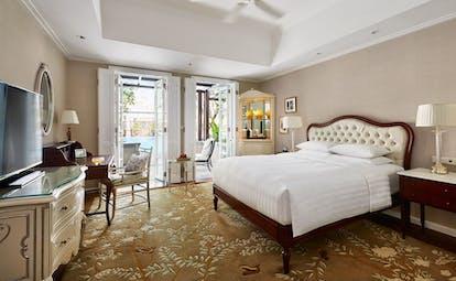 Park Hyatt Saigon deluxe room, double bed, desk, french windows leading to balcony, elegant decor