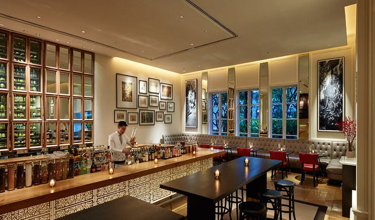 Park Hyatt Saigon opera bar, elegant modern decor, bartender mixing drinks,
