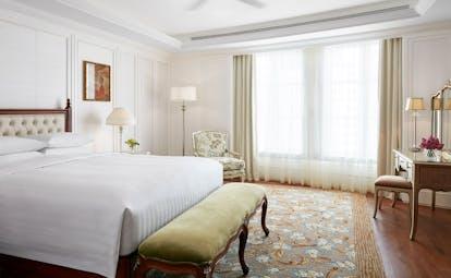 Park Hyatt Saigon presidential suite bedroom, double bed, vanity table, bright elegant decor