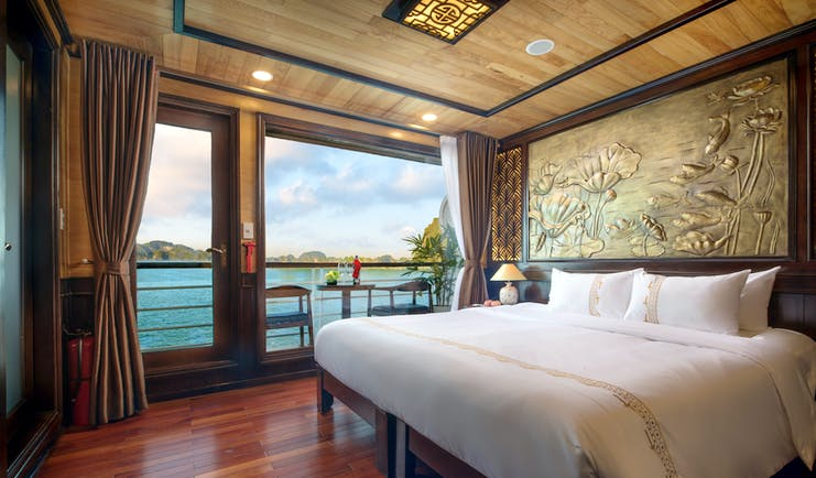 Perla Dawn Sails Cruise double room, bed, traditional decor, floral wall engraving, large windows with view over sea
