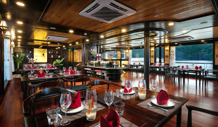 Perla Dawn Sails Cruise restaurant on board boat, wooden floors and ceiling, wide windows with views over sea