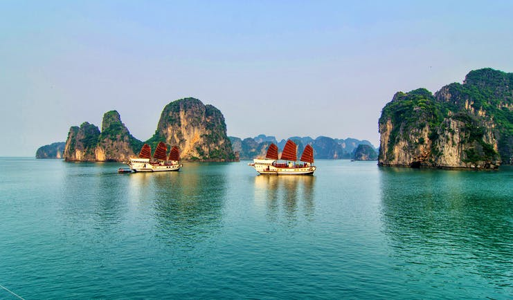 Red Dragon Junk cruise, two boats on water in Ha Long Bay