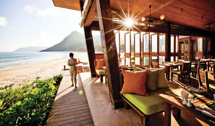 Six Senses Vietnam beach restaurant exterior terraced dining area on beach front