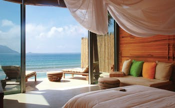 Six Senses Vietnam deluxe pool villa bed sofa private terrace private pool