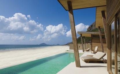 Six Senses Vietnam ocean front villa exterior infinity pool terrace sun lounger