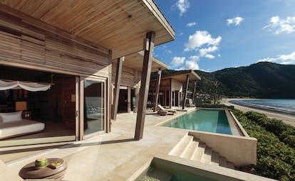 Six Senses Vietnam pool villa exterior pool terrace sun loungers beach views