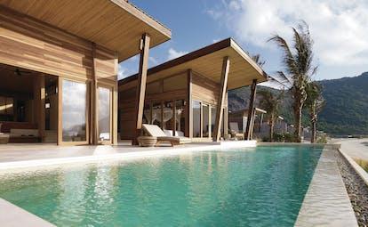 Six Senses Vietnam pool villa pool private terrace sun lounger beach views