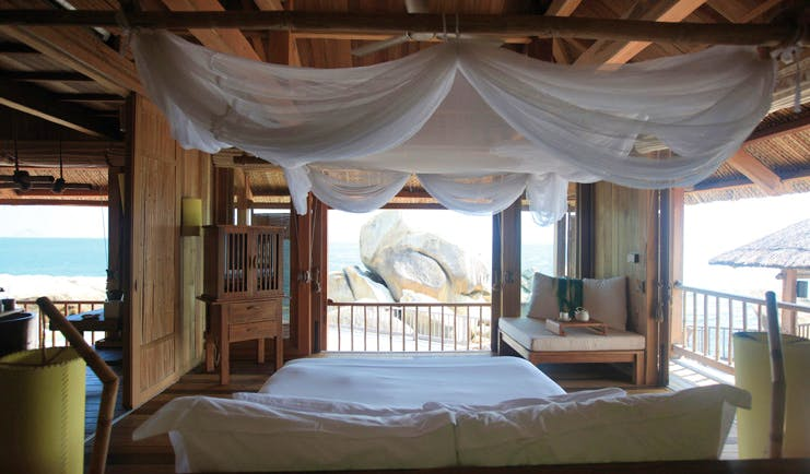 Six Senses Ninh Van Bay Vietnam presidential villa bedroom beach and rock view