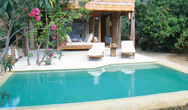 Six Senses Ninh Van Bay Vietnam private pool villa exterior loungers trees and gardens