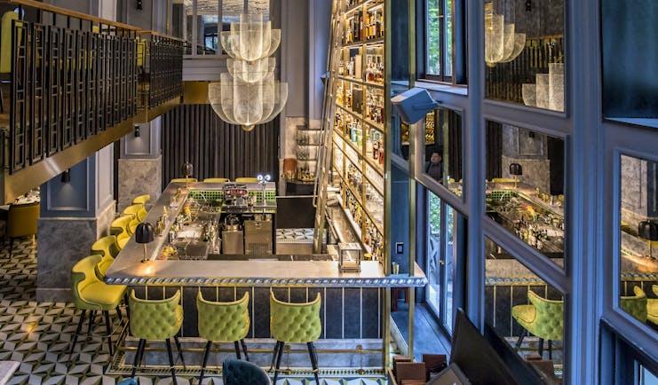 Sofitel Metropole Hanoi bar, modern elegant decor, chandeliers, bar stools