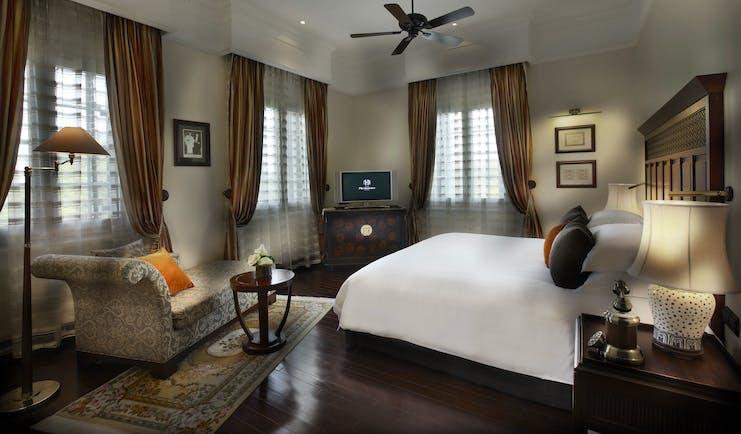 Sofitel Metropole Hanoi legendary suite, double bed, sofa, grand decor