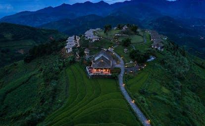 Topas Ecolodge resort, hotel buildings nestled onto hillside, mountains in background
