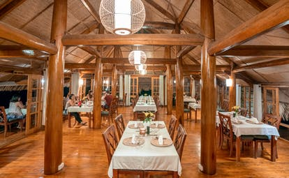 Topas Ecolodge restaurant, modern dining area, exposed wood beams, tables and chairs