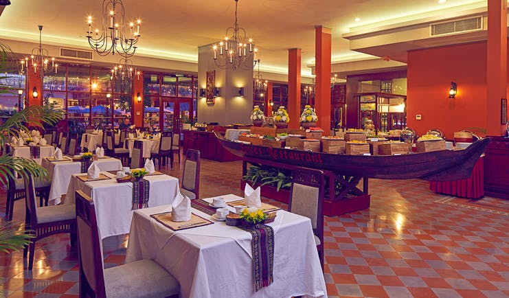 Victoria Can Tho Resort restaurant, traditional decor, tables and chairs, chandeliers