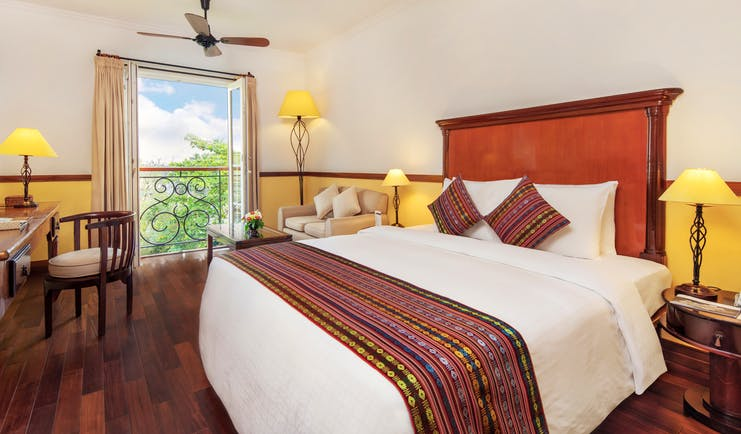 Victoria Can Tho Resort superior guestroom, double bed, bright modern decor, juliet balcony
