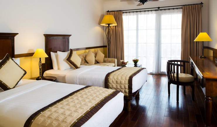 Victoria Can Tho Resort twin superior guestroom, beds, large window, traditional decor