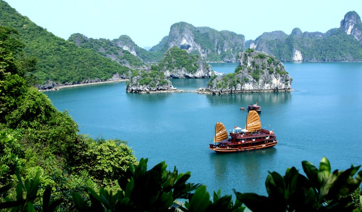 Ha Long Bay, junk boat on the water, surrounded by rock formations, sea