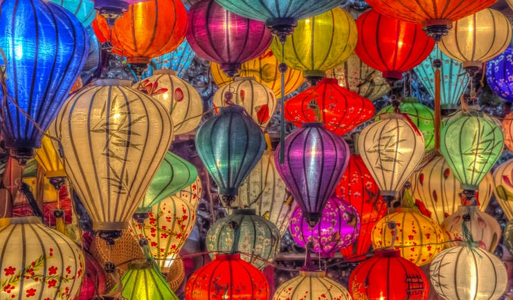 Lanterns for sale in Vietnam, multicoloured and intricate designs, traditional paper lanterns