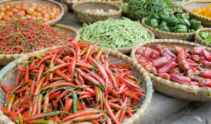 Vegetables for sale at a market in Hanoi, chillies, peppers, green beans tomatoes, onions