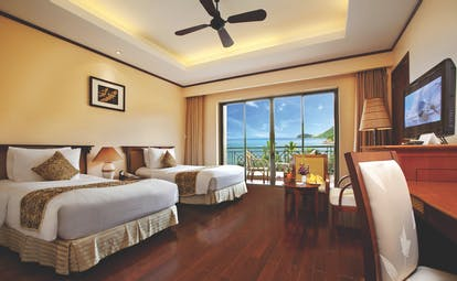 Vinpearl Luxury Nha Trang Vietnam grand deluxe room twin beds access to terrace ocean views