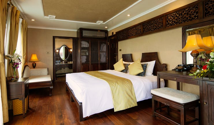 Violet Cruise imperial suite, double bed, armchair, wardrobe, tradtional decor, wooden details