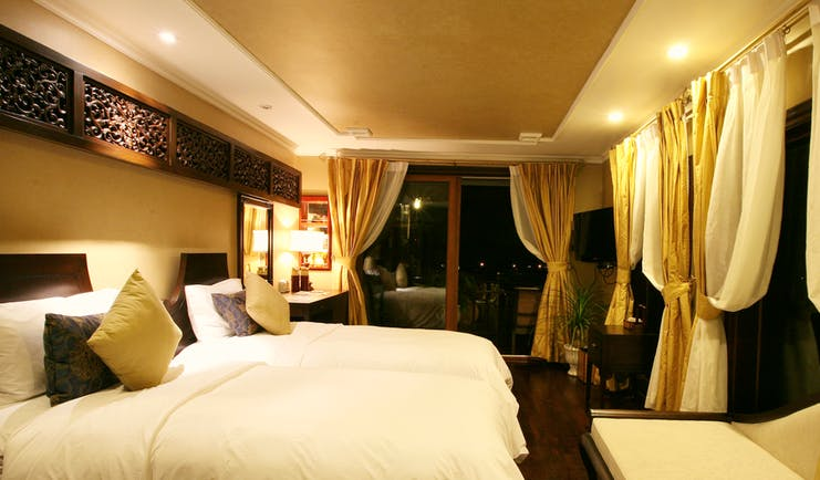 Violet Cruise junior suite, twin beds, traditional decor, large windows, curtains