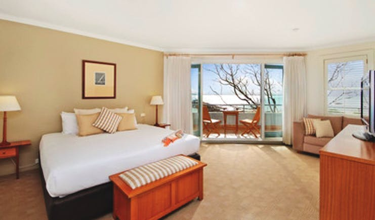 Anchorage Port Stephens New South Wales and Sydney bedroom with sofa and doors to balcony